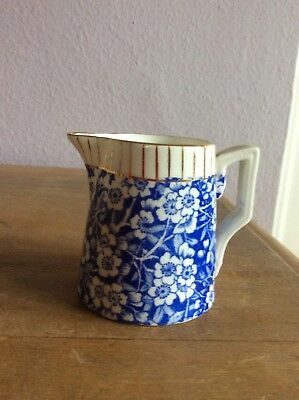 Blue and white floral jug 7 cms.tall