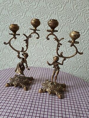 A Pair Of French Brass Boy And Girl Candlesticks