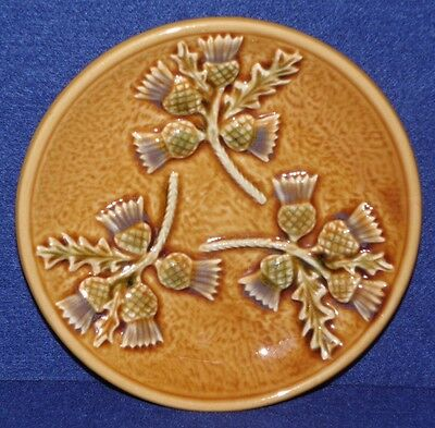West Highland Pottery, Dunoon, circular plate, Thistle decoration, 17cm diameter