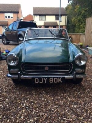 Classic MG Midget with wire wheels and chrome bumpers