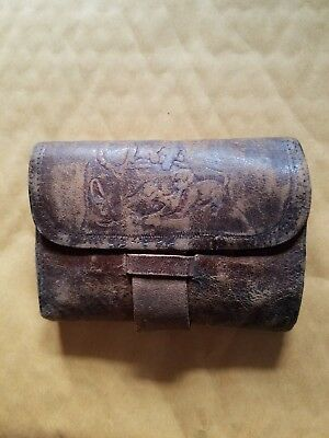 Late 1800s civil war era brown leather wallet with dog design multiple folds