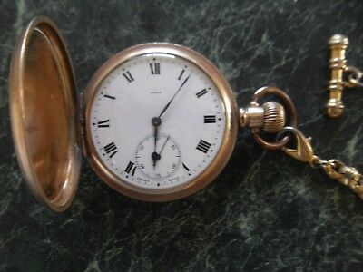Old Pocket watch and chain.