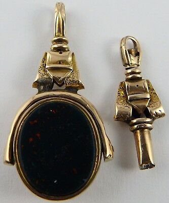 Pair of antique 9ct gold swivel spinner watch fob and matching key.