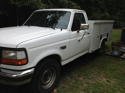 1996 Ford F-250 Xl Ford F-250 power stroke diesel with utility bed and lift gate.