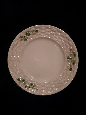 Belleek cream plaited plate with shamrocks. 2nd black mark 1891 -1926, 16cm dia