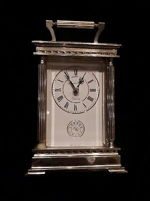 Silver carriage clock with 'London Clock LCC 1925' written on face. 16cm high.