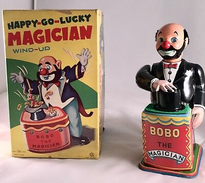 Happy Go Lucky Magician Tin Windup....Mint