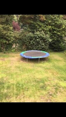 14ft Trampoline, with no net but, blue and green matting on the side