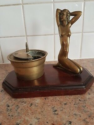 Brass candle holder and figure