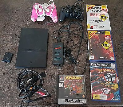 Playstation 2 slim console - 2 controllers + 4 games + memory card