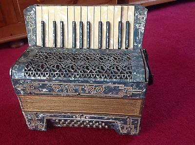 Pietro Piano Accordion with Carry Case for parts or repair does play