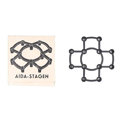 A boxed Danish Aida Stagen candlestick Modernist metal design Circa 1960