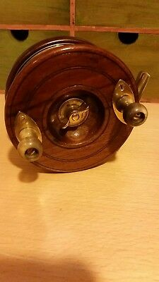 Vintage wooden and brass star back Fishing Reel