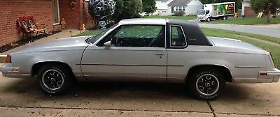 1987 Oldsmobile Cutlass Supreme Classic '87 Oldsmobile Cutlass Supreme SE, Silver/Blue, Auto. 3.8L V6, 2Dr Coupe