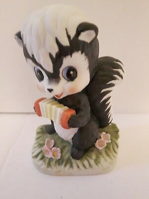 "skunk playing accordion ceramic painted 4"" figurine marked Taiwan TWR-25691"