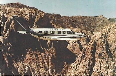 Rare LAS VEGAS AIRLINES issue Piper Navajo in the Grand Canyon postcard MINT