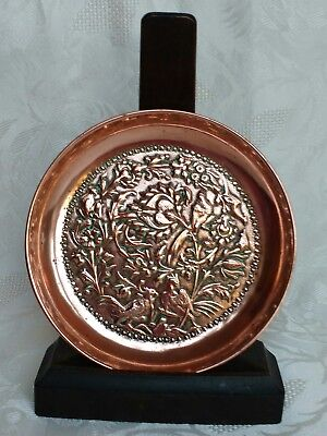 Early 20th century repousse copper Persian dish Birds amidst foliage Beautiful