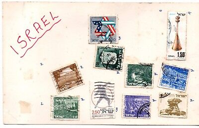Israel stamps. 10 used believed from 1970s. Hinged on card.