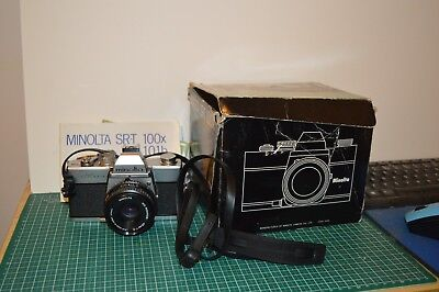 minolta  srt100x clc 35 mm slr camera with 45mmf2 lens and box and instructions