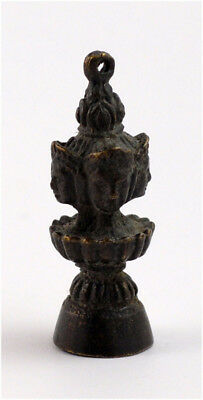 A bronze Tibetan buddhist four faces pendant