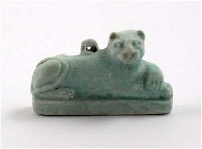 Egypt Late Period to Ptolemaic Period a reclining lion amulet