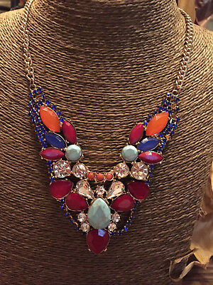 Jewel toned bead and rhinestone necklace in red, amber, pale turquoise, and blue
