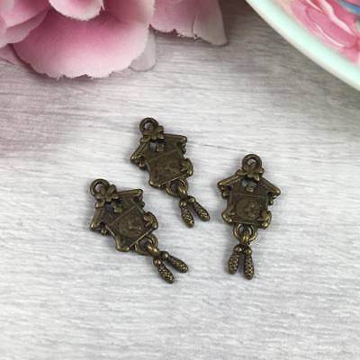 25 x Antique Bronze CUCKOO Clock Charms 25mm x 11mm VINTAGE Pendants Kitsch UK