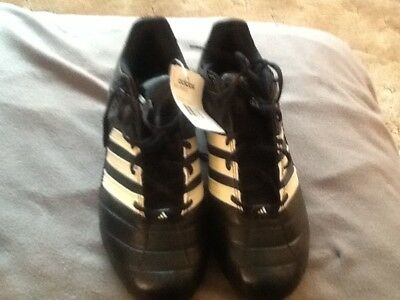 Adidas grid iron D football cleats/spikes mens size 13, black n white