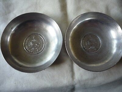 Two vintage metal Lion and Sun engraved Iranian coin  bowls
