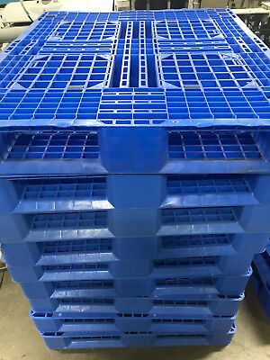 Blue Plastic Pallets - Used with scratches and pallet jack/fork lift fractures