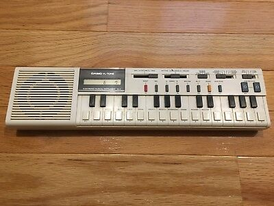 Vintage CASIO VL-1 VL-TONE electronic musical instrument calculator keyboard