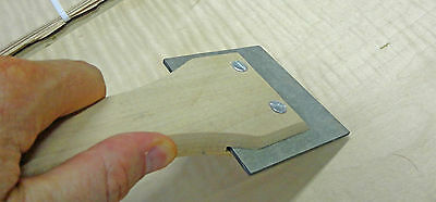 Wood veneer application scraper tool for paper and wood backed veneer products
