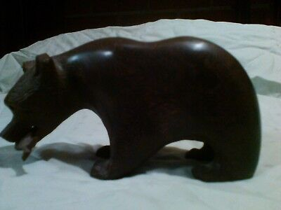 vintage hand carved black walnut grizzley with fish