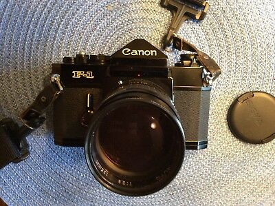Vintage Canon F-1 35mm Camera Black With Working Meter. And A Focal Mc Auto 1:2.