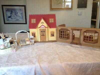 Sylvanian Families. Cottage. Dolls house with furniture and dolls. Plus extras.
