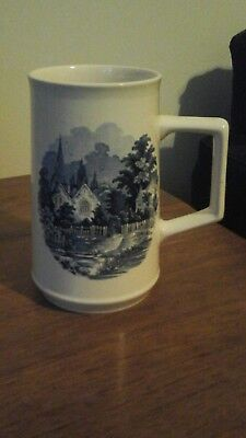 Holkham pottery tankard blue and white village scene