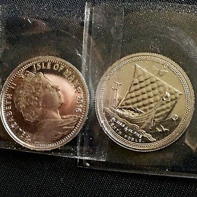 Two (2) 2016 .9995 Platinum 1/10 oz Isle Of Man Coins still in factory plastic.