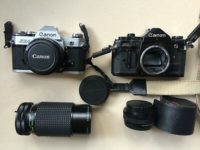 Lot of (2)  Canon AE-1 and A-1 Cameras & JC Penny lens / FOR PARTS - AS IS
