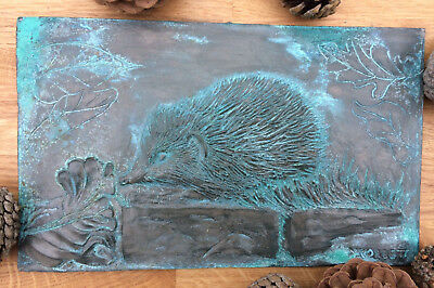 Antique effect hedgehog wall plaque, aged metal finish wall art, animal present