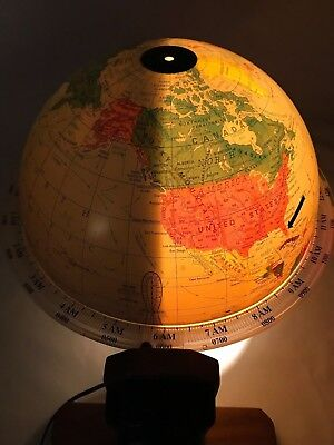 Sunlit lighted world rotating globe Of Seattle with oak stand Vintage Rare Used