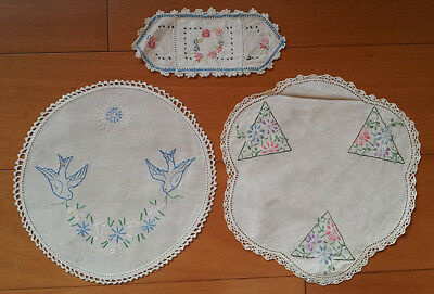 Doilies (2), and napkin holder, all embroidered, vintage