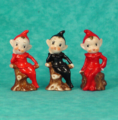 Lot of 3 Christmas Vintage Red and Black Porcelain Pixies Sitting on Logs