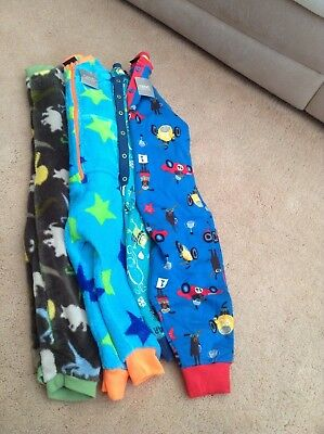 4 childs jump suits all size 2-3 years.