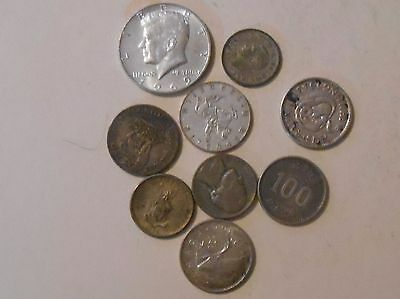 50.1 grams of silver coins from all over the world