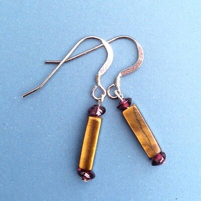 Small modern tigers eye and garnet earrings. Sterling silver earwires.Irish made