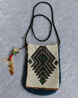 Vintage Native American blue hide bag or pouch with beaded flap Geometric design