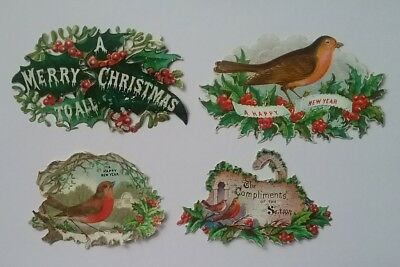4  emboss diecut Victorian Christmas/New Year  Greetings Scraps. Largest 8×4cms.