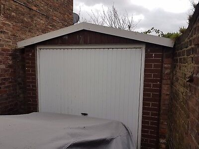 Concrete Garage with Remote Control Electric Door and Steel Roof Frame.