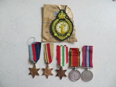 WW2 medals Issued to HJ Du Toit. Sth Africa Group of 5 plus cloth breast badge