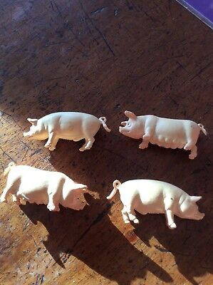 Toy Farm animals 4 pigs.2 males, 2 females. Good condition. Made in China.